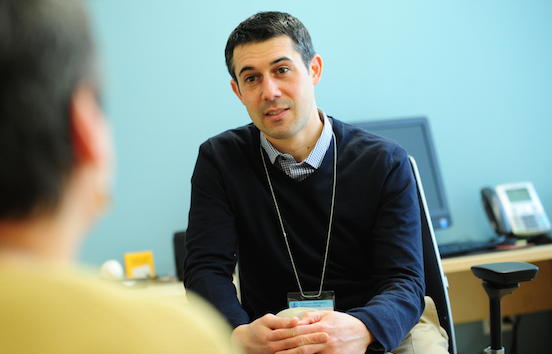 Dr. Anthony Puliafico consults with patient
